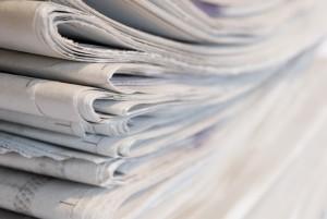 Pile of newspapers, narrow focus.